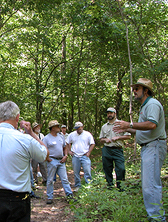Man (Jeff) Talking to Group of People in Forest